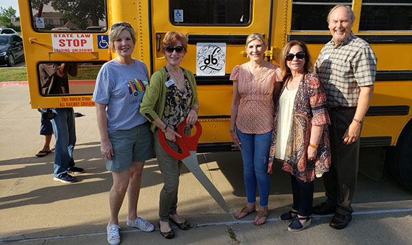 Denton Benefit League School Bus donation